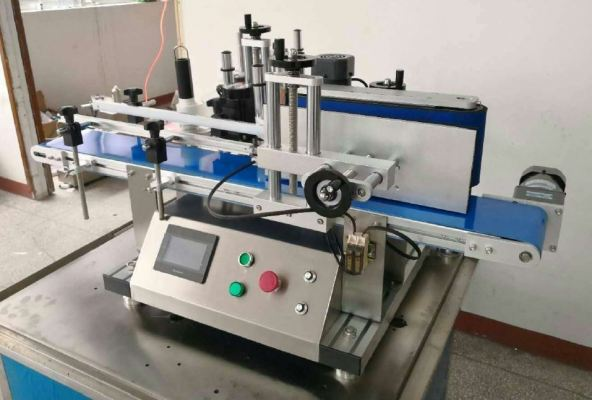 Automatic table top round bottle labeling machine