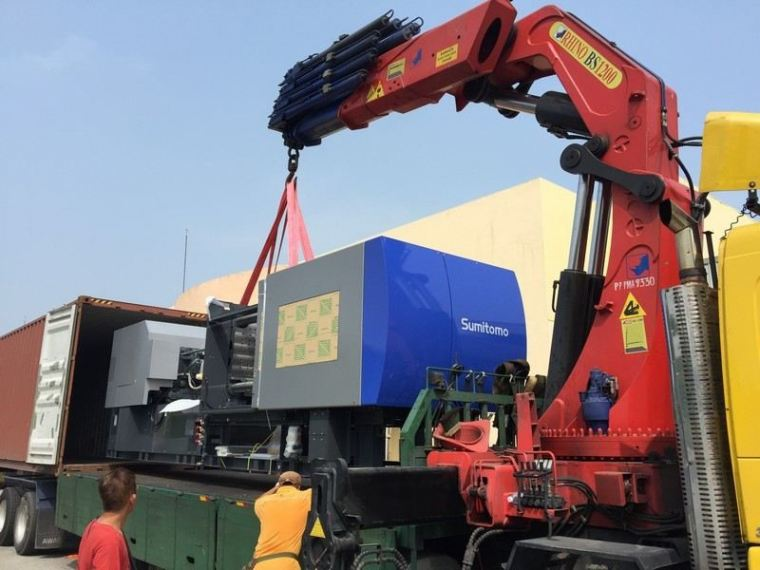 loading heavy machinery to the shipping Container Logistics Forwarder & Transportation