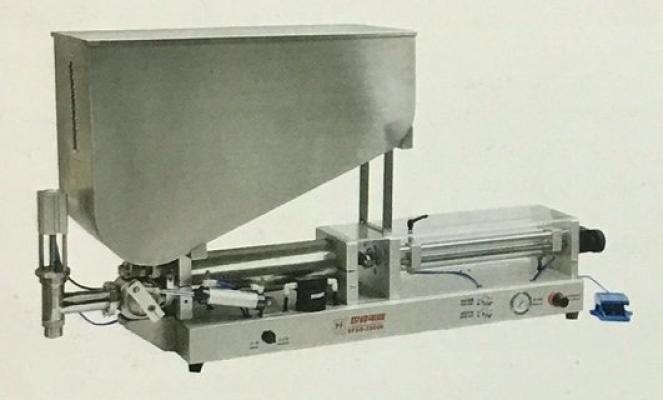 Pneumatic single nozzle cream filling machine