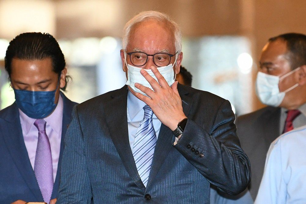 Najib claims bankruptcy notice an attempt to disqualify him as MP after poll puts him as frontrunner