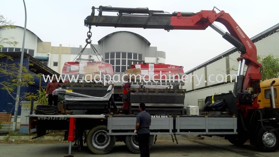 Stuffing 3 Units Used Amada Hydraulic Pressbrake into Container