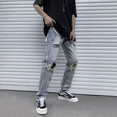 LONG RIPPED JEANS WITH ZIP 02