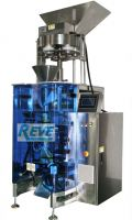 VERTICAL FORM FILL SEAL PACKING MACHINE WITH VOLUMETRIC CUP SYSTEM